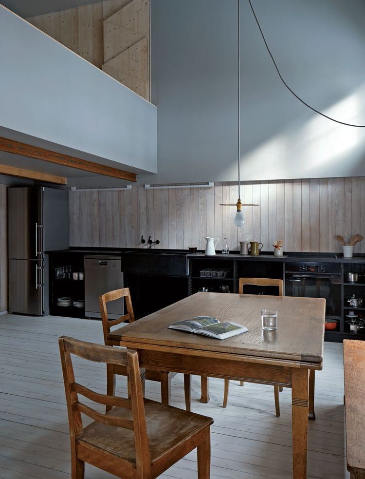 Swiss family getaway small space renovation with Ize pendant in dining kitchen area