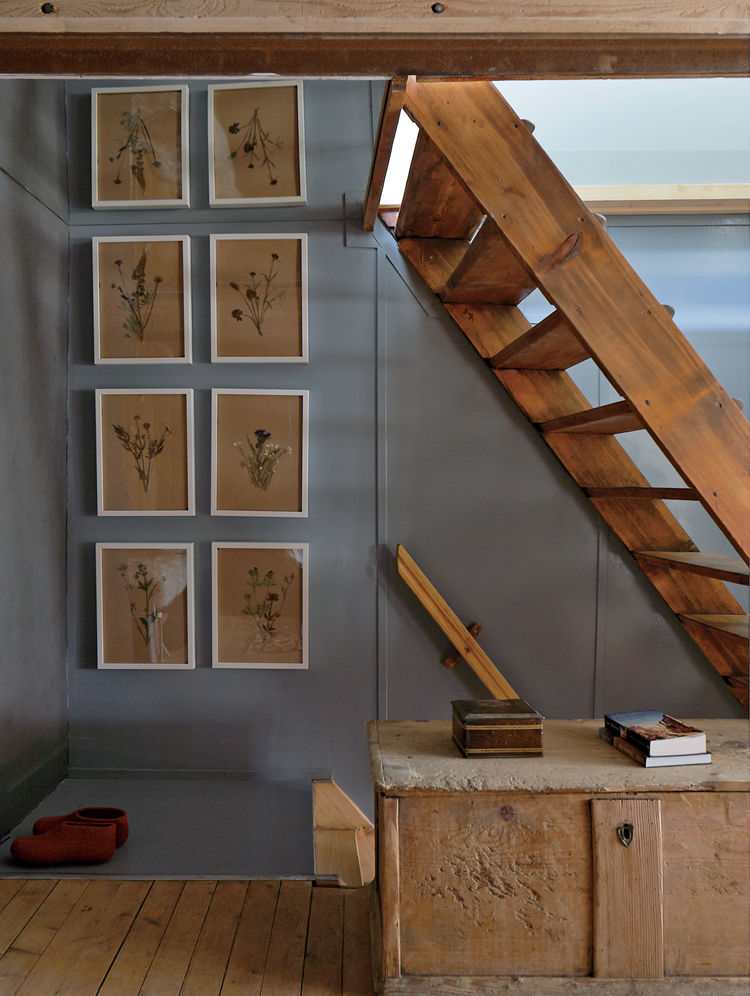 Swiss family getaway small space renovation with stubli and wood stairs