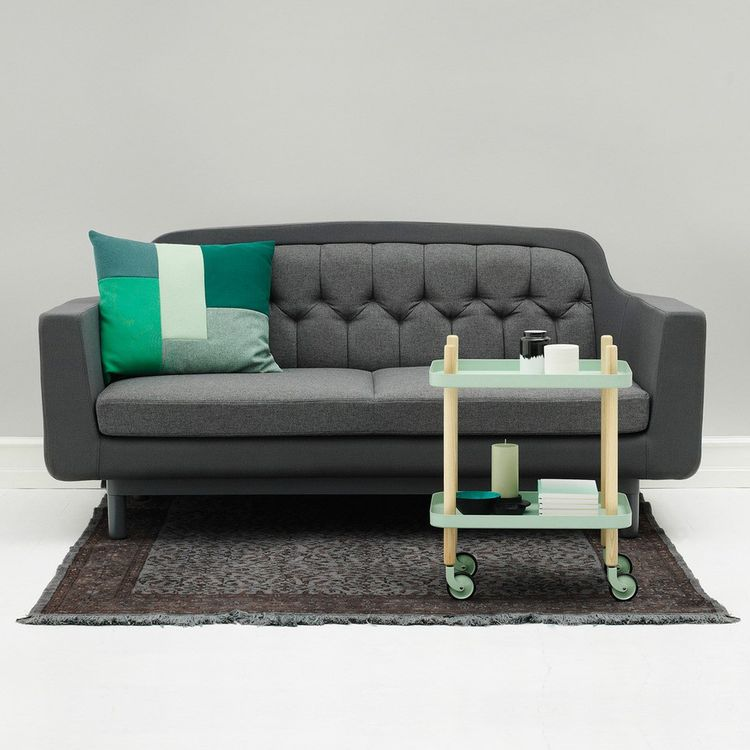 Sofa connecting traditional design with modern details