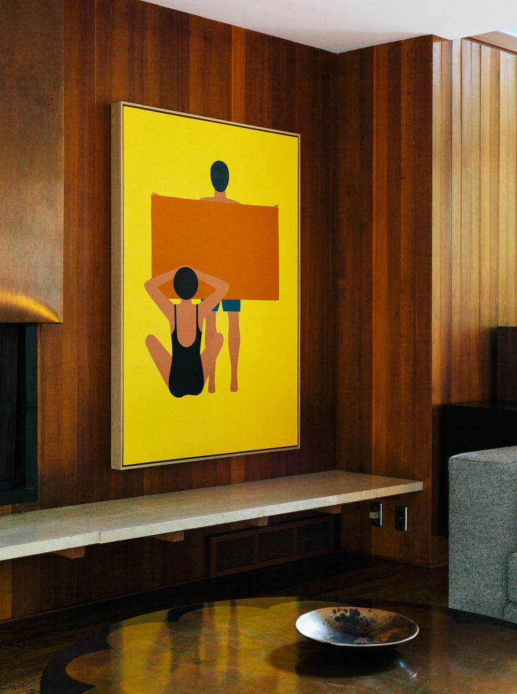 A Geoff McFetridge painting hangs in this modern home's living room.