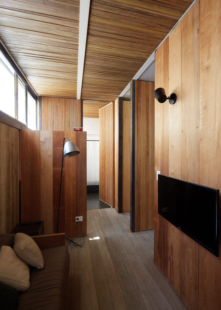 The wood flooring is salvaged pine from a warehouse in Brazil.