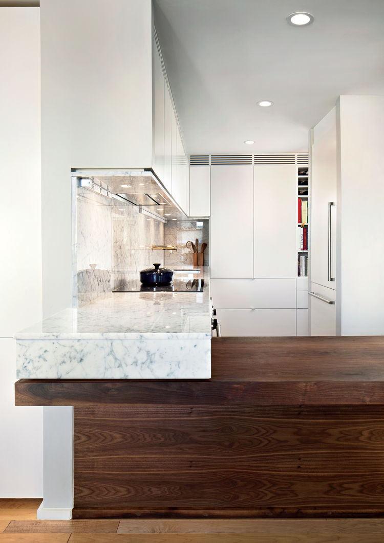 Mondern Boston family kitchen renovation that's wheelchair accessible with marble countertop bar