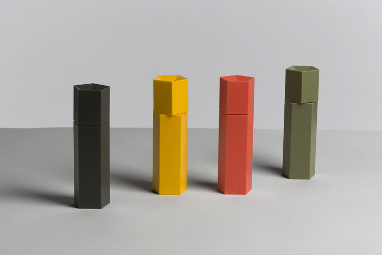 Colorful salt or pepper grinders with geometric shape