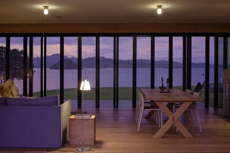 Oiled oak floors in living room of New Zealand retreat.