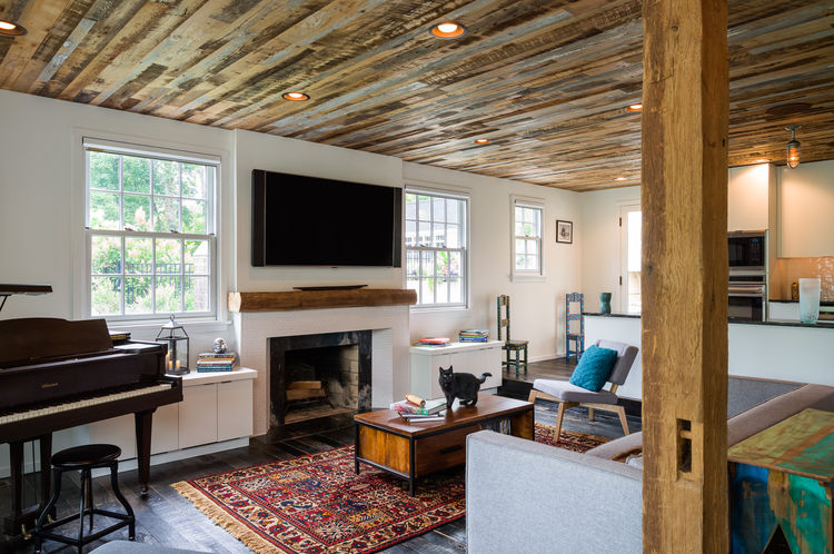 Original brick fireplace in living room in a renovated Pennsylvania Colonial