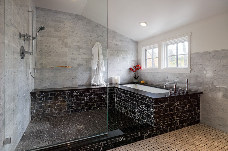Marble master bathroom in a renovated Pennsylvania Colonial