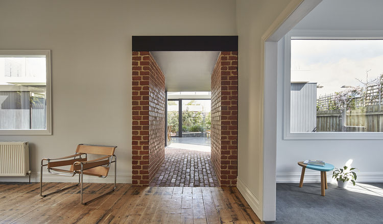 Recycled brick passageway between old home and its modern addition.