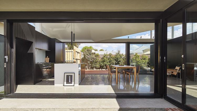 Masson for Light Apollo pendants over Falcon oven in kitchen of Melbourne addition.