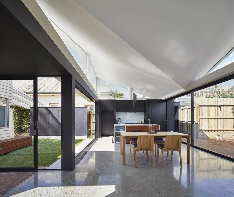 Indoor-outdoor dining space of Australian home.