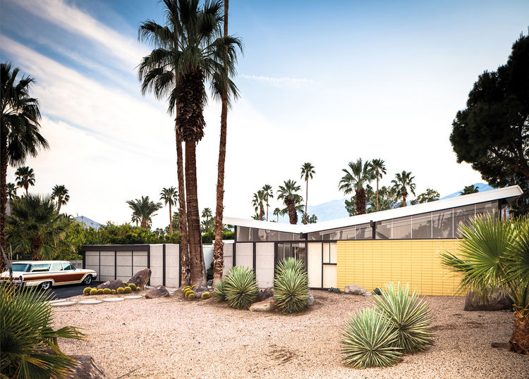 Tract house with a butterfly roof in Palm Springs by William Krisel