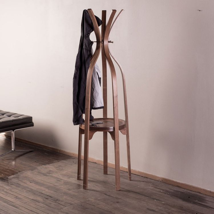 Sculptural coat stand with shelf