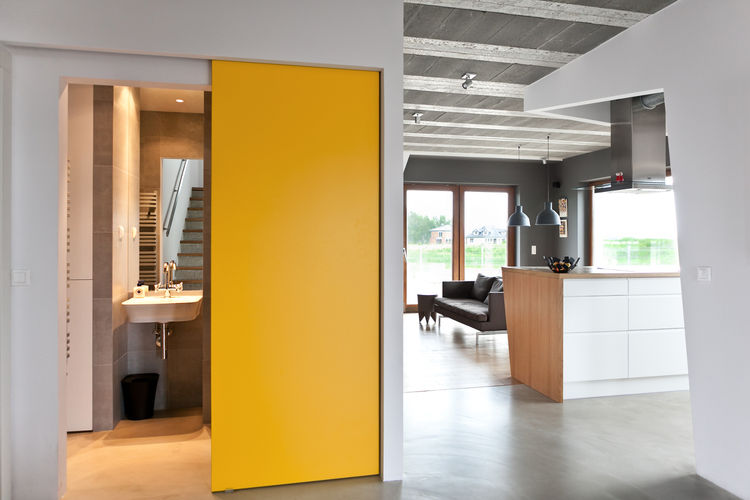 Yellow sliding door to the bathroom