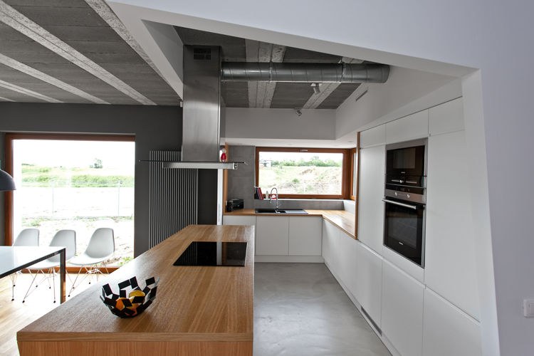 Modern kitchen in Poland with white custom cabinets