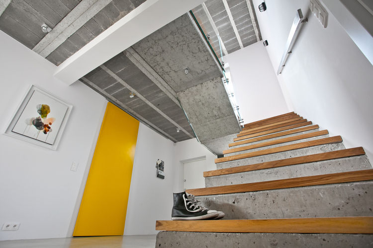 Polish house with exposed concrete and stairs