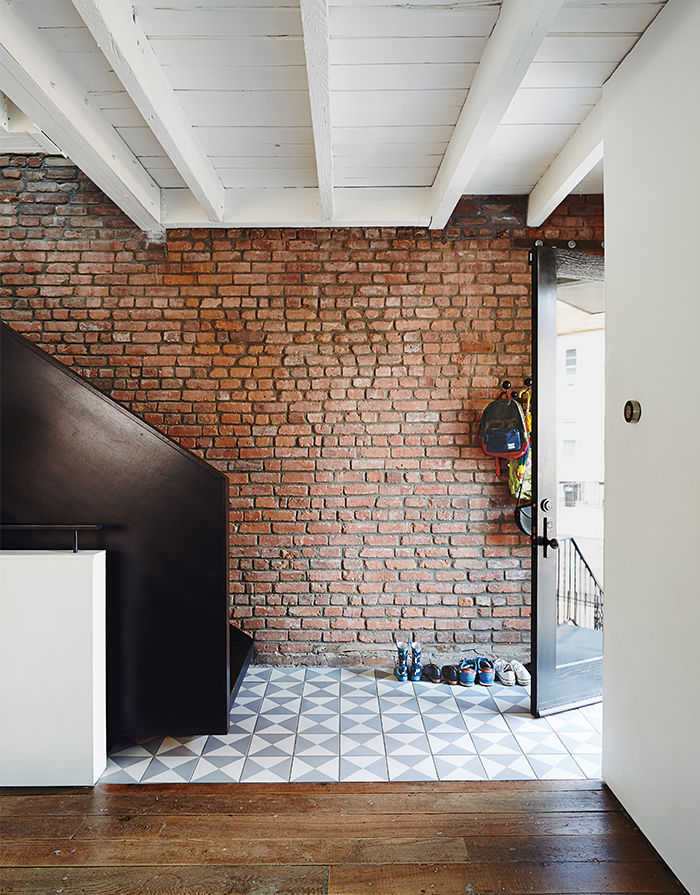 Modern Brooklyn renovation has blackened steel staircase and reclaimed ash flooring