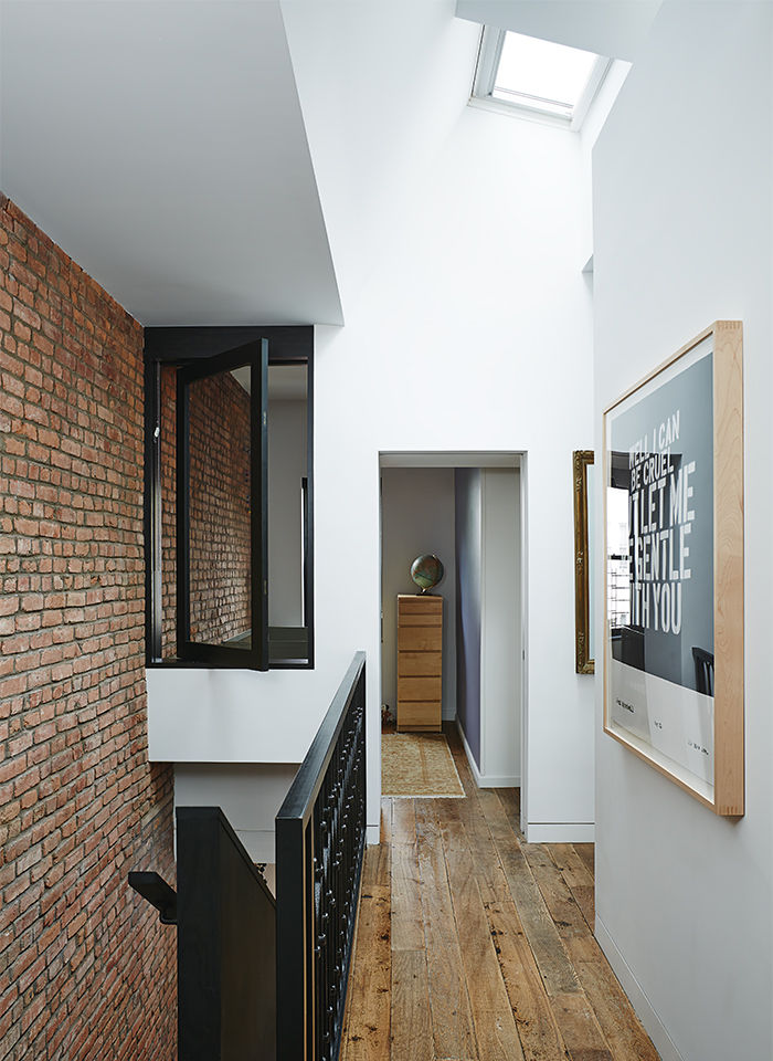 Modern Brooklyn renovation has interior skylight in hallway