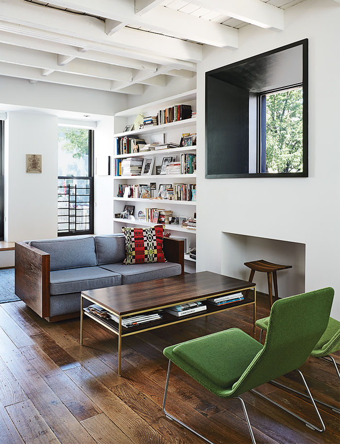 Modern Brooklyn renovation has vintage sofa and Vitra chairs in the living room