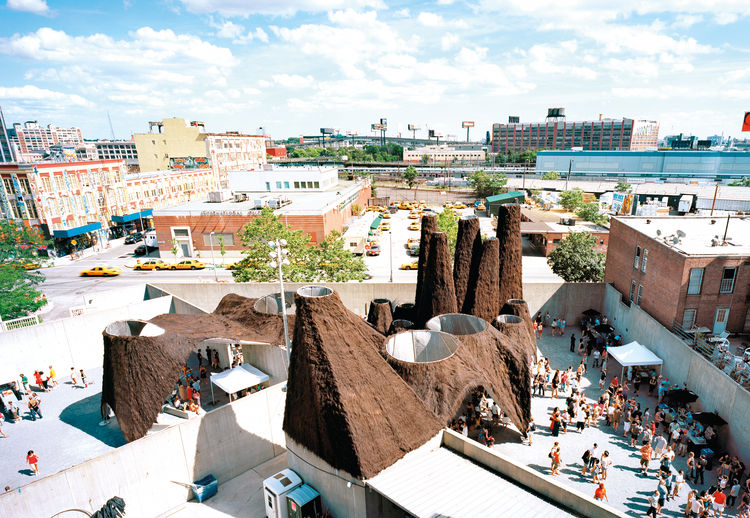 MOMA PS1 Afterparty design of thatched thermal chimneys.