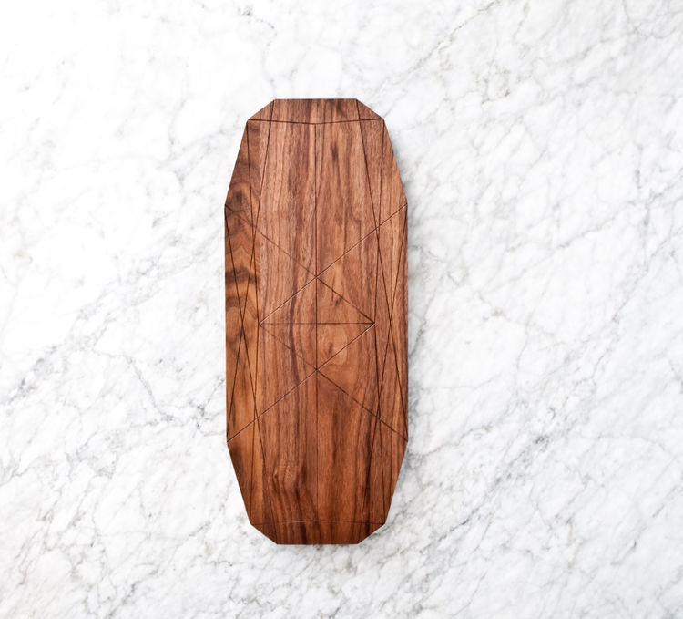 Long walnut serving board with beveled edges