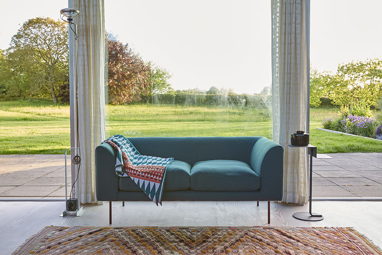 Turquoise loveseat by Terence Woodgate