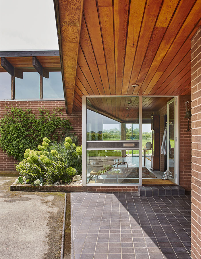Modern glass door of a 1970s house in England
