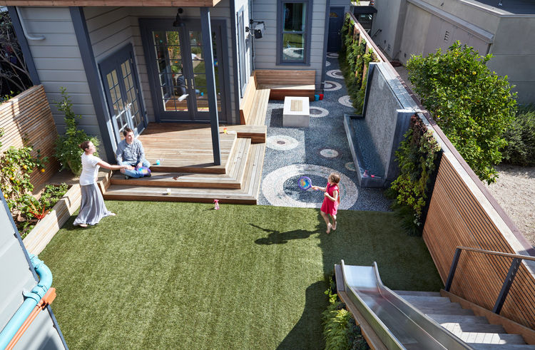 A pebble mosaic and artificial turf divide the yard of a San Francisco home