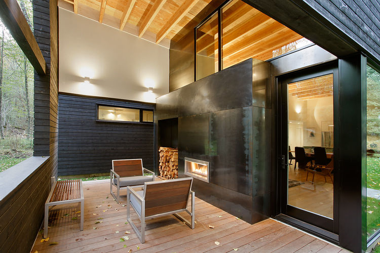 Steel-clad fireplace warming ipe-decked patio.