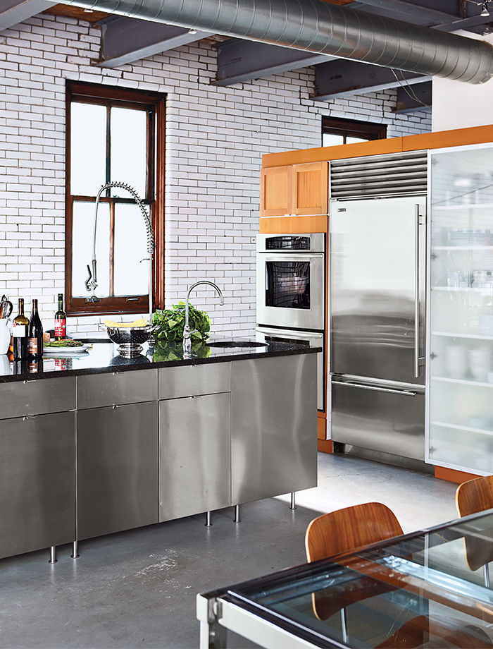 kitchen in Modern home renocation in Chicago with stainless steel island, subway tiles, and copper windows