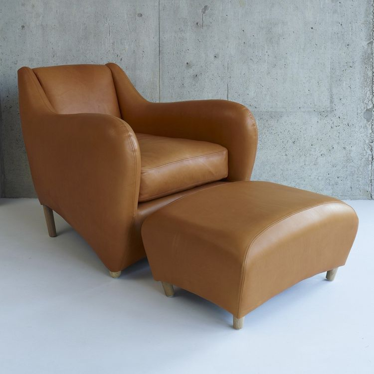 Statement leather lounge chair and ottoman