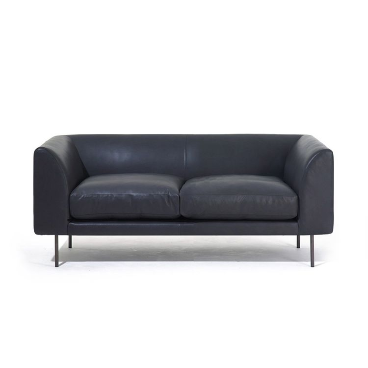 Sophisticated leather two-seater sofa with steel legs