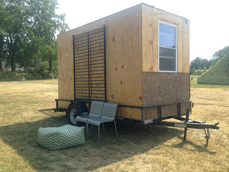 A mobile art studio with chairs and beanbag