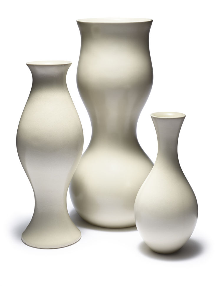 Sculptural ceramic vase set including large, medium, and bud-sized vases