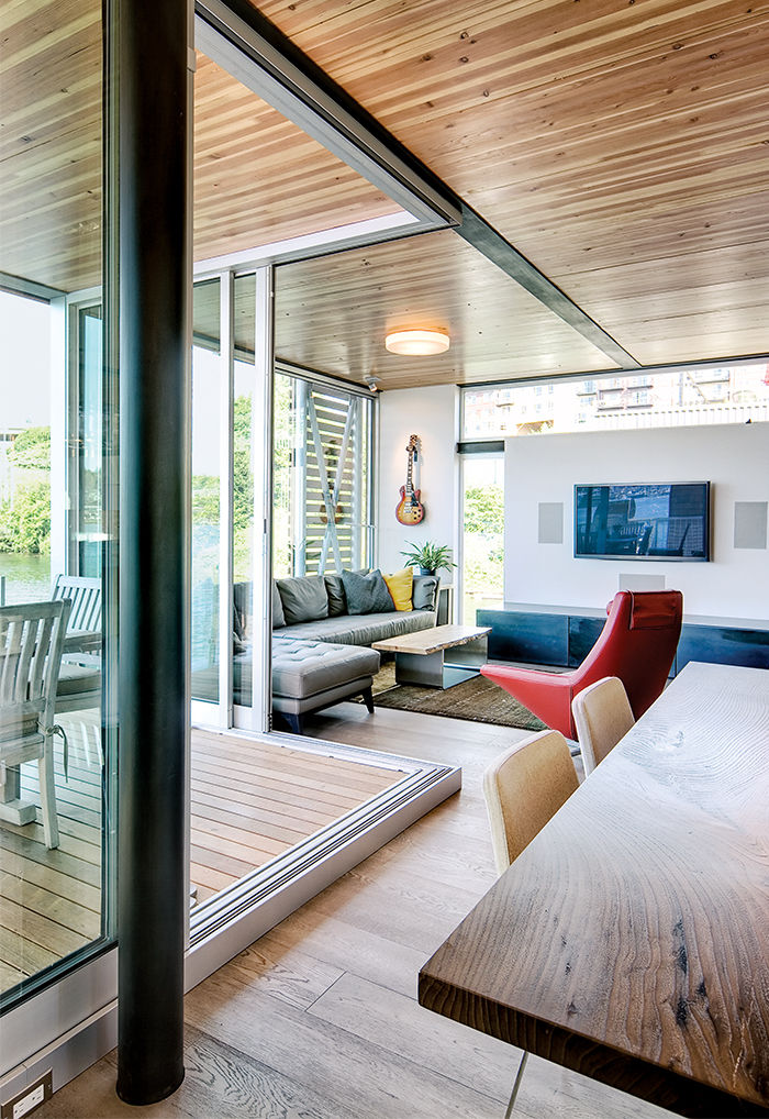 Prefab floating home in Seattle with windows in the living area