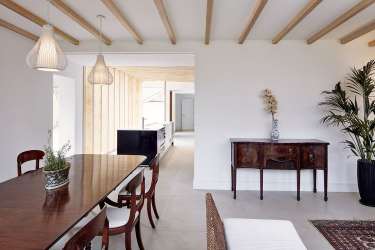 A mix of furniture and exposed beams nicely complement each other