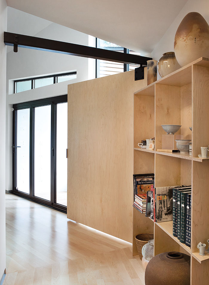 Modern addition for an Alzheimer's patient with open shelving and a wide door