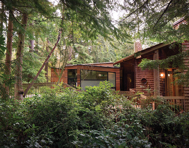 Cedar home with a modern addition in the Pacific Northwest