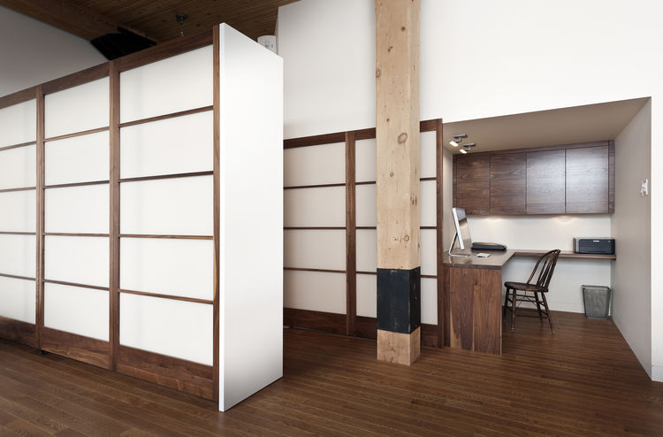 Shoji-inspired storage in 850 square-foot Montreal apartment renovation by Gepetto.