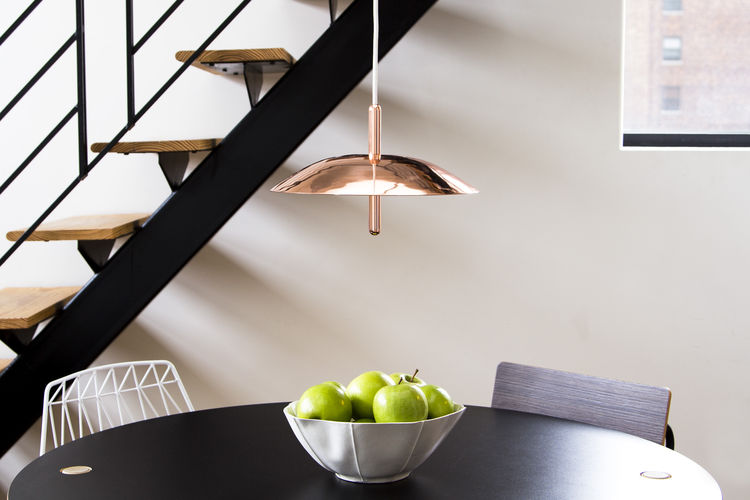 Hanging pendant light in spun aluminum with copper plate