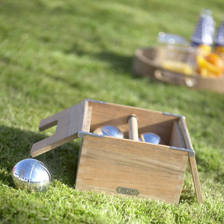 Classic lawn game with chrome balls and teak box