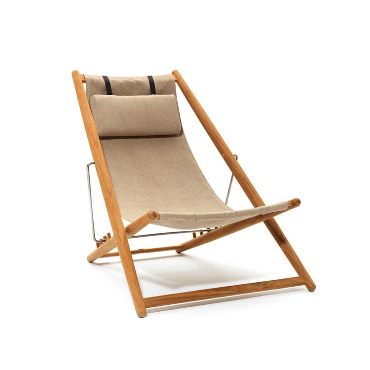 Lounge chair made of teak, fabric, and steel