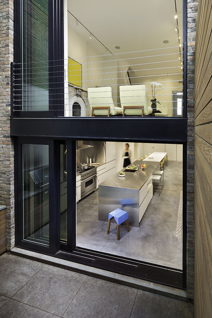 Modern West Village renovation with sliding door to kitchen and patio