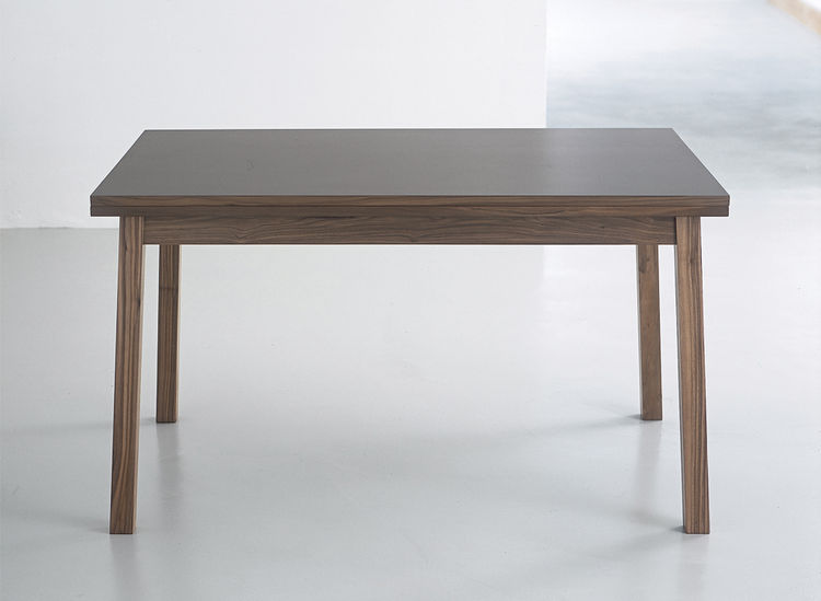 kite table by steuart padwick for resource furniture made of laminate and walnut veneer