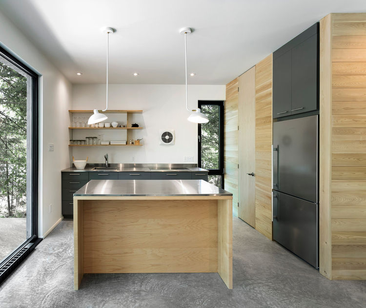Modern kitchen with gray laminate countertops and stainless steel countertops