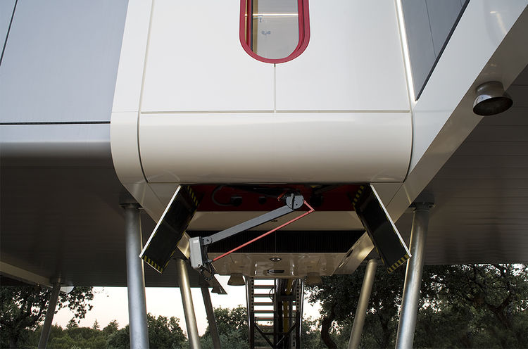 Electric car charging station underneath the spaceship prefab in Spain