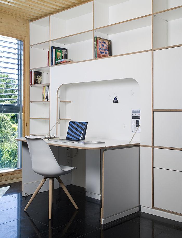 Built-in folding desk in the spaceship prefab in Spain