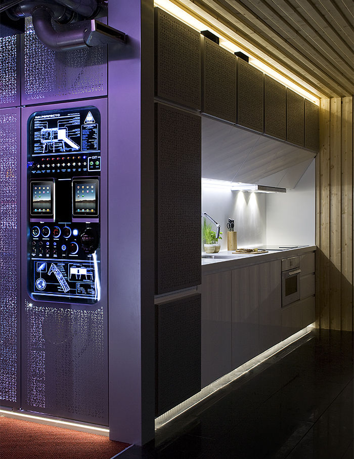 Purple mechanical hub and kitchen in the spaceship prefab in Spain