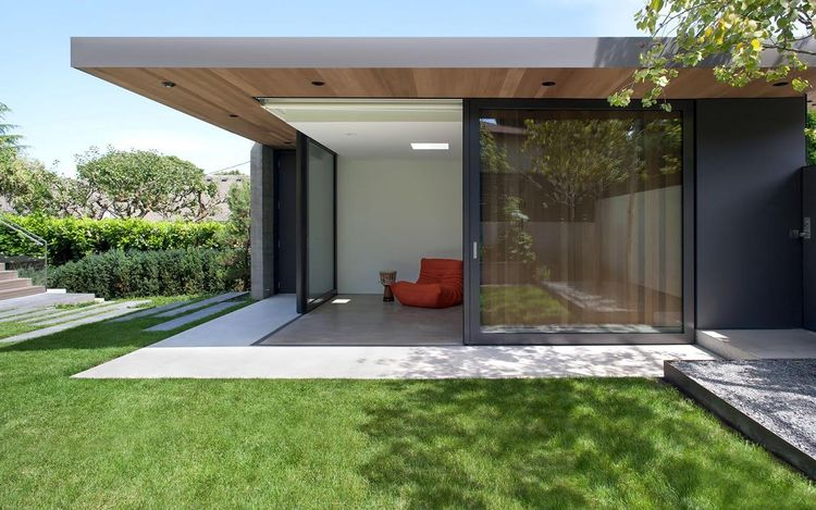 Backyard addition in Iron Mountain by Benjamin Moore by Splyce Design.