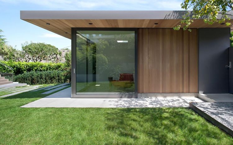 Sliding glass door of Vancouver addition by Splyce Design.