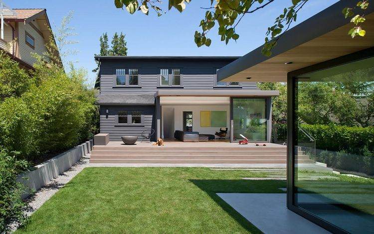 Backyard with red cedar deck of Vancouver renovation by Splyce Design.