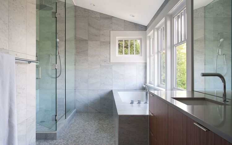 Bathroom with marble mosaics and Blue Bathworks fixtures in Vancouver renovation by Splyce Design.
